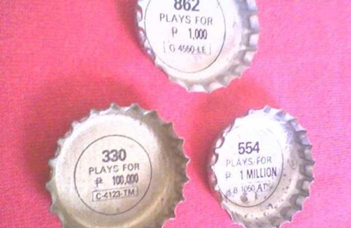 Tapones de Pepsi con la promoción Number Fever - el café de la Historia Pepsi 349